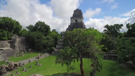 Great-aerial-shot-over-the-Tikal-pyramids-in-Guatemala-12
