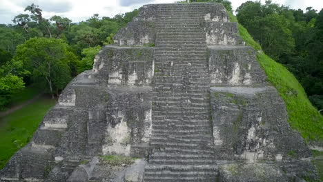 Spectacular-aerial-shot-over-the-Tikal-pyramids-in-Guatemala-2