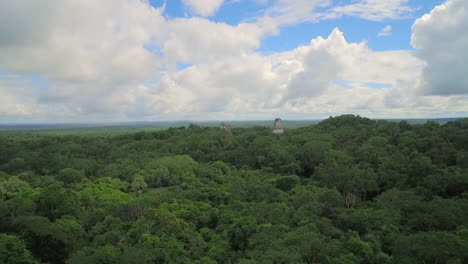 Spectacular-rising-aerial-shot-over-the-Tikal-pyramids-in-Guatemala-1