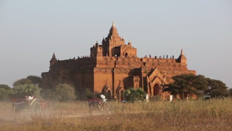 Busses-approach-the-stone-temple-on-the-plains-of-Pagan-Bagan-Burma-Myanmar