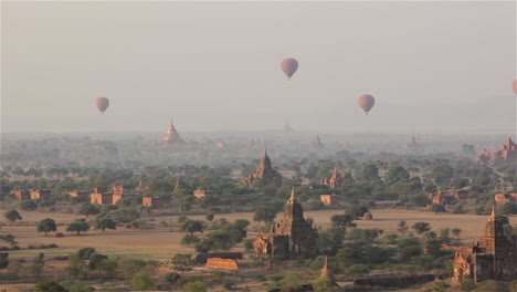Balloons-fly-above-the-stone-temple-on-the-plains-of-Pagan-Bagan-Burma-Myanmar
