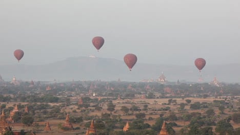 Balloons-fly-above-the-stone-temple-on-the-plains-of-Pagan-Bagan-Burma-Myanmar-1