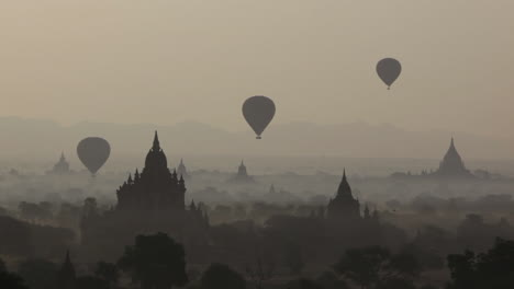 Balloons-fly-above-the-stone-temple-on-the-plains-of-Pagan-Bagan-Burma-Myanmar-2