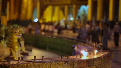 Candles-burn-at-a-Burmese-temple