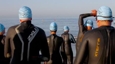 Triathlon-swimmers-enter-the-ocean-2