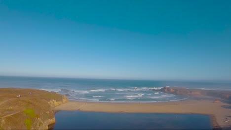 An-aerial-over-a-generic-foggy-beach-near-Big-Sur-California-revealing-footbridge