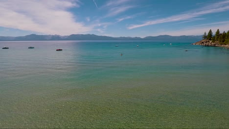 An-aerial-over-a-woman-paddling-a-kayak-across-Lake-Tahoe