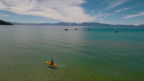 An-aerial-over-a-woman-paddling-a-kayak-across-Lake-Tahoe-2