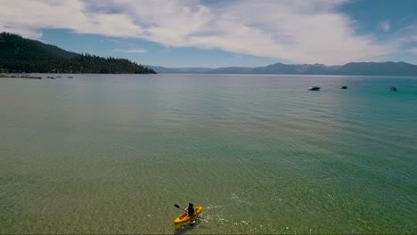 An-aerial-over-a-woman-paddling-a-kayak-across-Lake-Tahoe-3