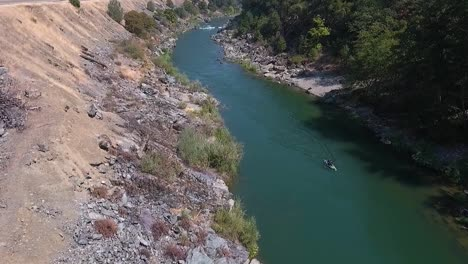 Aerial-drone-shot-of-white-water-rafting-on-a-beautiful-sunny-day-on-the-Trinity-River-in-Northern-California-3