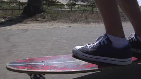 A-skateboarder-maneuvers-his-way-along-a-seaside-sidewalk