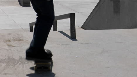 A-skateboarder-ollies-onto-a-rail-and-grinds-his-way-down