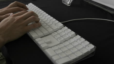 Hands-type-rapidly-on-a-white-keyboard