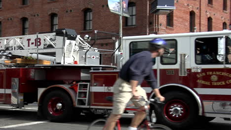 A-hookandladder-fire-truck-turns-a-corner-in-an-urban-area