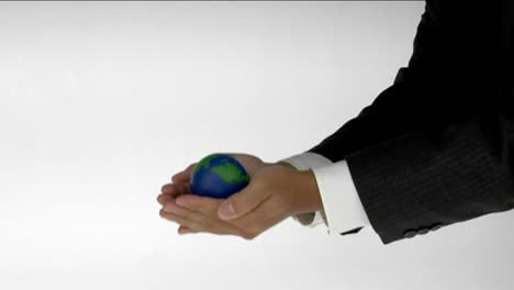A-pair-of-cupped-hands-hold-a-small-globe