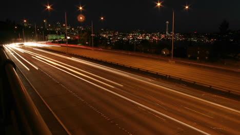 Traffic-drives-along-a-Seattle-freeway-at-night