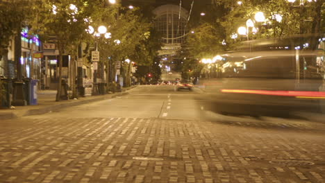 Traffic-drives-through-a-downtown-area-in-time-lapse