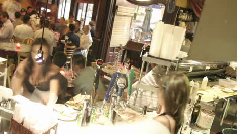 A-panning-shot-across-a-busy-bar-in-time-lapse