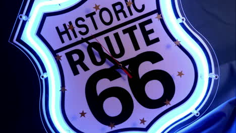 "Clock-hands-spin-on-a-neon-Historic-Route-66""""-clock-face"""""