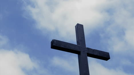 Clouds-move-in-the-sky-above-a-wooden-cross