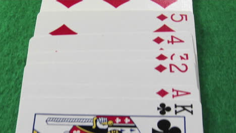 The-camera-moves-across-a-deck-of-cards-laid-out-on-a-casino-table