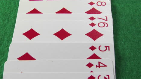 The-camera-moves-across-a-deck-of-cards-laid-out-on-a-casino-table-1