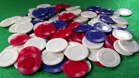 A-pile-of-poker-chips-on-a-green-felt-table