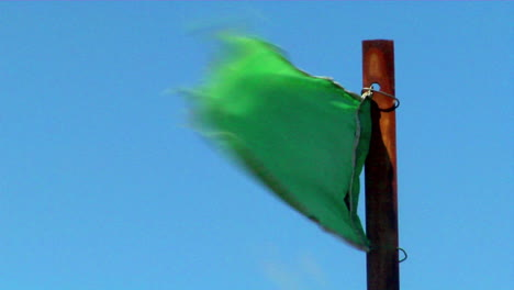 A-green-flag-blows-in-the-wind