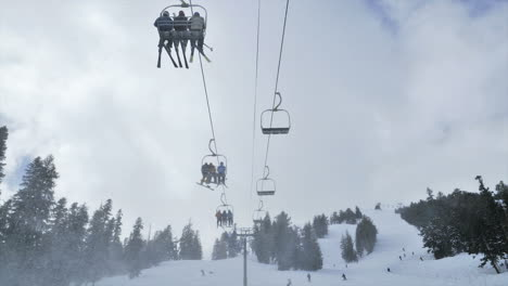 Timelapse-of-people-riding-up-a-ski-lift-in-the-mountains