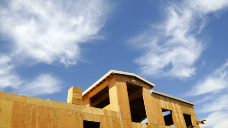 Timelapse-of-clouds-blowing-above-a-house-under-construction