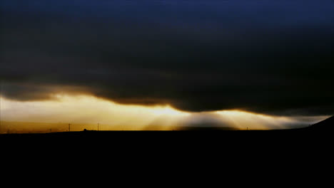 Time-lapse-of-cloudy-sunset-over-a-vineyard-1