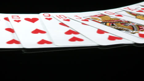 A-deck-of-cards-laid-out-rotates-in-front-of-a-camera