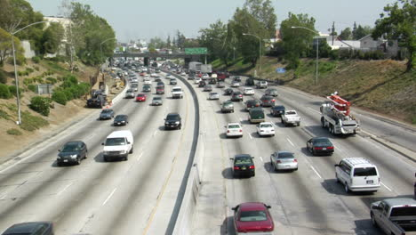 Heavy-traffic-moves-in-opposite-directions-along-a-four-lane-freeway-in-Los-Angeles