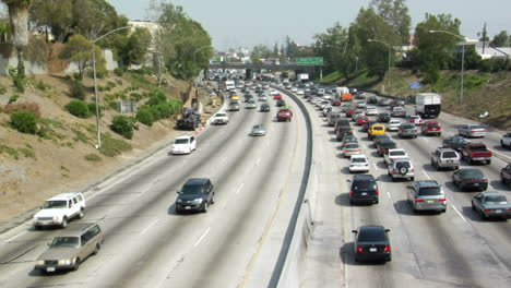 Traffic-moves-slowly-along-a-busy-freeway-in-Los-Angeles