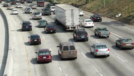Traffic-moves-slowly-along-a-busy-freeway-in-Los-Angeles-1