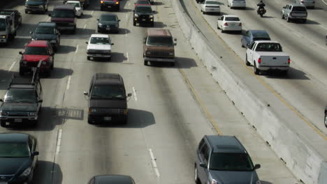Traffic-moves-slowly-along-a-busy-freeway-in-Los-Angeles-19