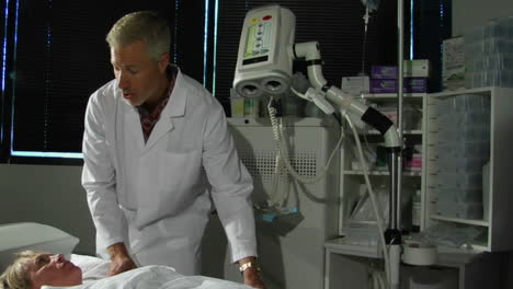A-doctor-prepares-a-patient-for-a-CAT-scan-1