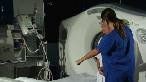 A-doctor-prepares-a-patient-for-a-CAT-scan-5