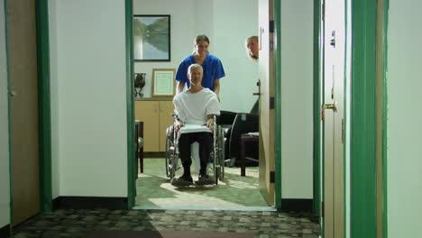 A-nurse-wheels-a-patient-down-a-hallway