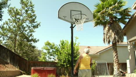 An-older-man-dribbles-and-shoots-a-basketball