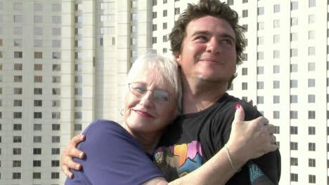 A-man-give-his-grandmother-a-hug