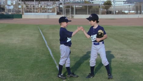 Little-league-baseball-players-give-each-other-playful-handshakes