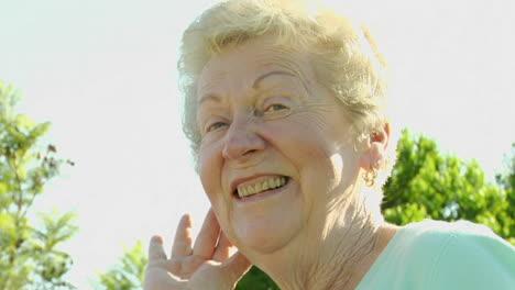 An-elderly-woman-fluffs-her-hair