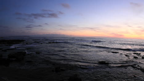 Waves-roll-on-to-a-beach-just-after-sunset-