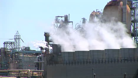 Steam-rises-from-evaporative-stacks-at-a-power-facility
