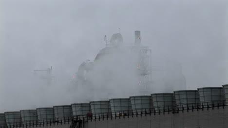 Smoke-rises-from-stacks-at-a-power-facility