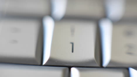 The-number-1-key-on-a-keyboard-comes-into-focus