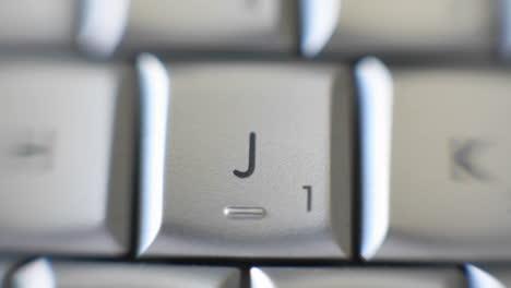Zoom-on-J-letter-on-a-keyboard