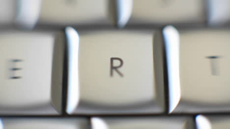 The-letter-R-focused-in-on-a-keyboard