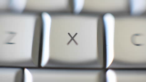 The-letter-X-on-a-keyboard-is-brought-into-focus